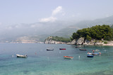 Boats In Montenegro Harbor With Blue Water poster