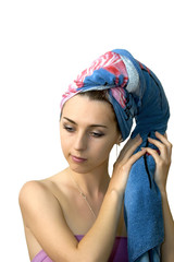 The isolated image of the girl drying hair after a shower