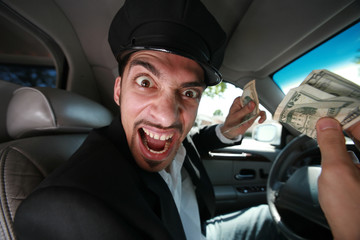 Angry driver with dollar bills.
