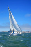 Beautiful yacht in San Francisco bay, the city on horizon poster