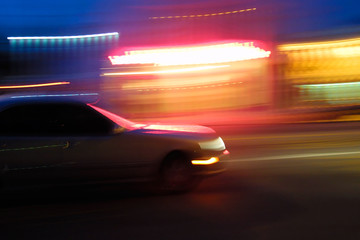 Fast moving car at night, blurred motion