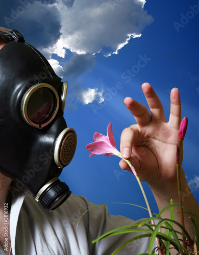 The man in a gas mask with flowers