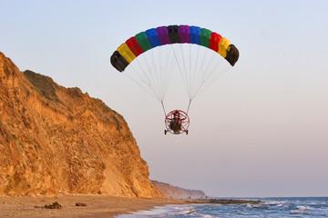 Flight on an operated parachute along coast of Mediterranean sea