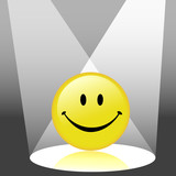 A shiny yellow smiley happy face emoticon in the spotlight. poster