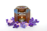Lamp for aromatherapy surrounded by violet petals poster