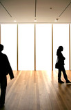 Silhouettes over blank windows in a generic hallway poster