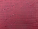 textured burgundy crushed silk background, close-up poster