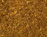 Loose cuts of dried tobacco form golden background texture poster