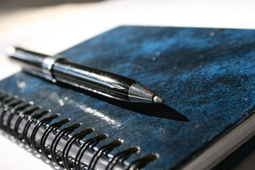 notebook with the pen