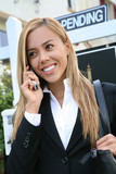 A beautiful real estate agent woman on the phone poster