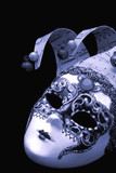 Venetian mask, on black, with cyan tone. poster