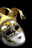 Golden Venetian mask, on black. poster