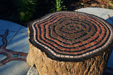 mosaic tree rings on a tree stump seat poster