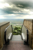 An escalator perched above the Italian countryside. poster