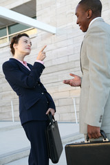 Two business people talking outside the company