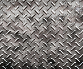 a very large sheet of rough black diamond plate with pits
