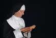 Middle aged devout nun in deep thoughts, praying.