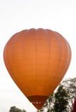 A hot air balloon beginning to lift poster
