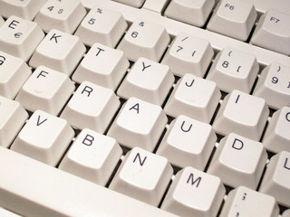 Keys on a computer keyboard spell out the word fraud