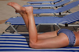 Legs of a girl in a stripped swimsuit  poster