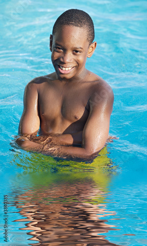 boy in the swimming pool in summer