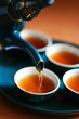 roleta: Pouring fresh tea to elegant china teacups.