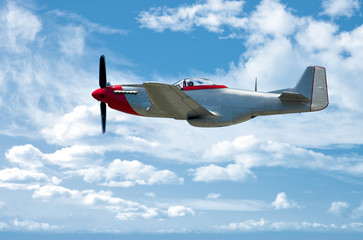 P-51 Mustang fighter against a clear blue sky