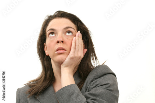 Worried business woman in a suit isolated over white background