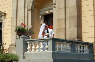 young wedding pair kissing