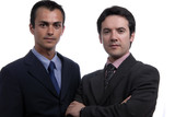 two young business men portrait on white. focus on the left man