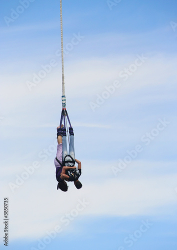 Couple bungee jumping off a tower