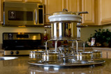 Stainless steel fondue set on the kitchen counter poster