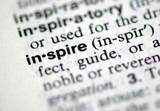 "A macro shot of the word ""Inspire"" from the dictionary"