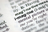 "A macro shot of the word ""Imagine"" from the dictionary"