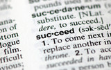"A macro shot of the word ""Succeed"" from the dictionary"