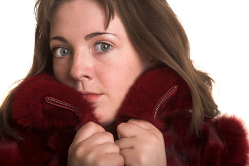 Young woman in fur coat isolated on white background