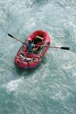 Woman in red raft in white water rapids, Alaska poster