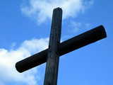 Old wooden Cross and the sky poster