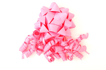 pink bow with lots of ribbons for placing on gifts, boxes etc.