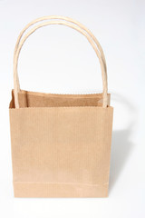 Empty brown paperbag isolated on white