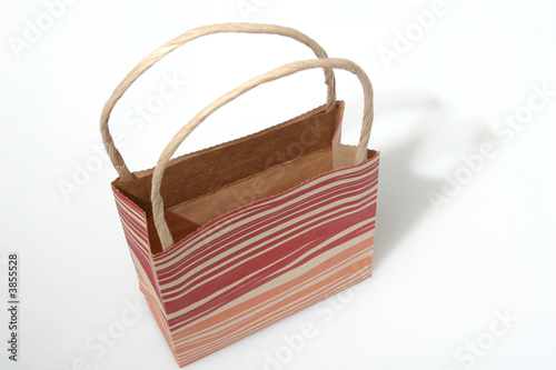 Empty red striped paperbag isolated on white