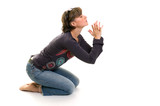 young women praying on her knees poster