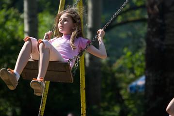 happy girl swinging