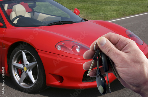 Car keys to red sports car