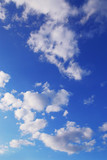 Background if bright blue sky with white fluffy clouds poster