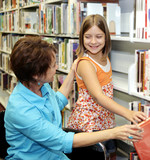A librarian helps a child choose a book.   poster