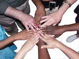 stacked hands of a diverse team to showcase teamwork poster