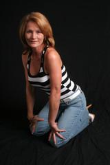 Pretty mature woman kneeling