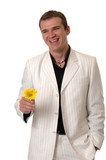 A smiling man offering a yellow flower to someone poster