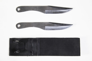 two knifes with a sheath on white background